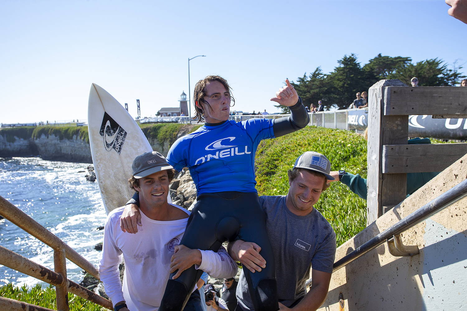 Sam Coffey being chaired up the stairs at Steamer Lane