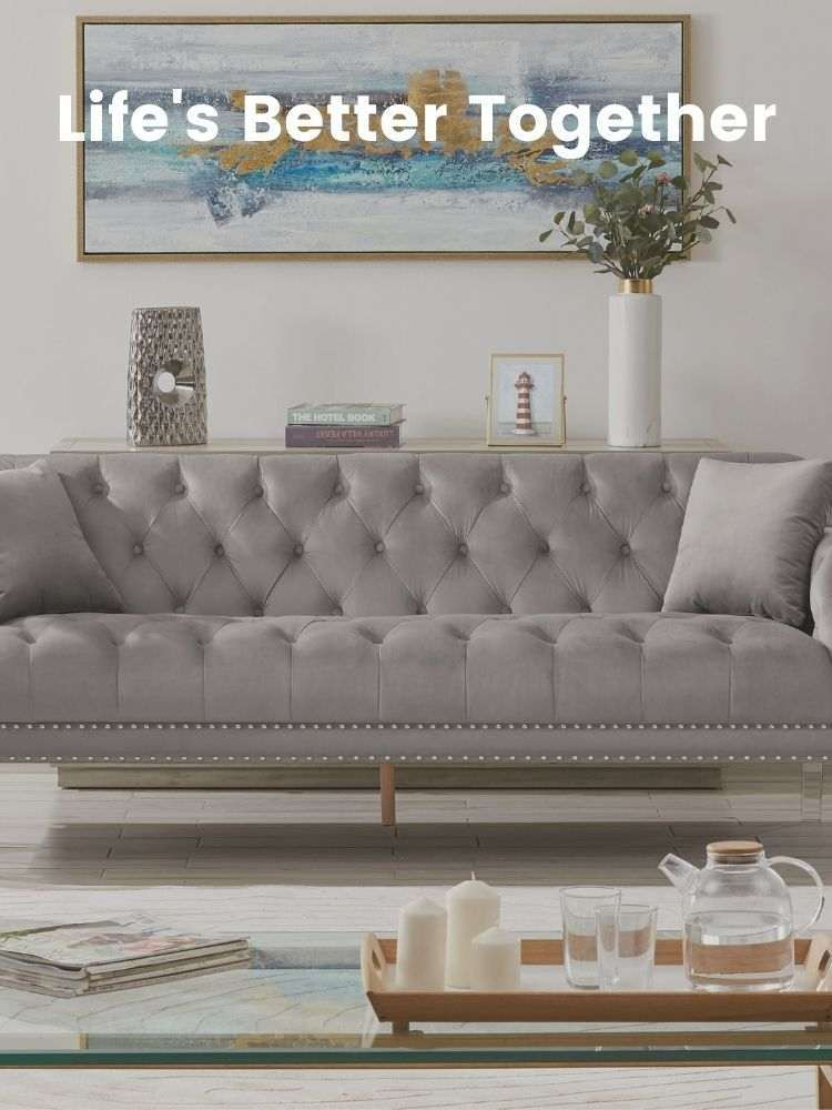 A living room with a grey Iconic Home Elsa velvet sofa in the middle