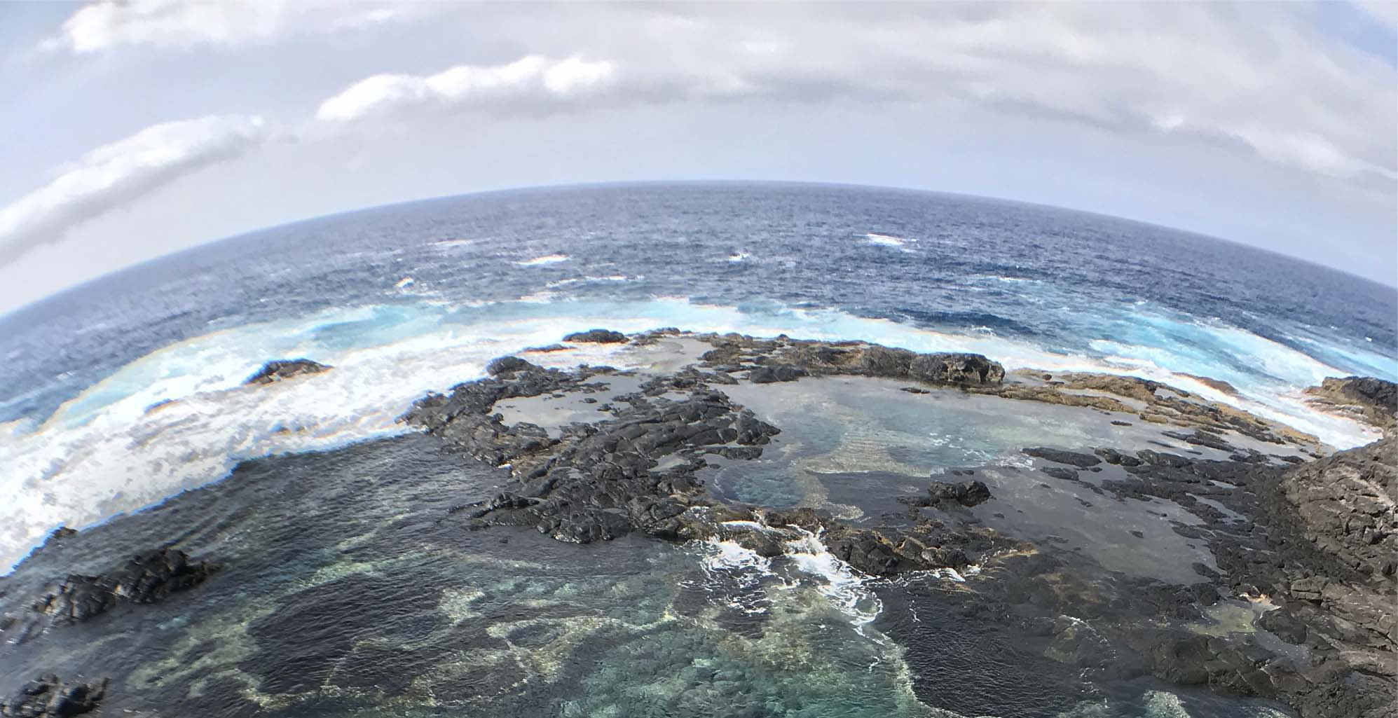 Fisheye lens of a rocky beach