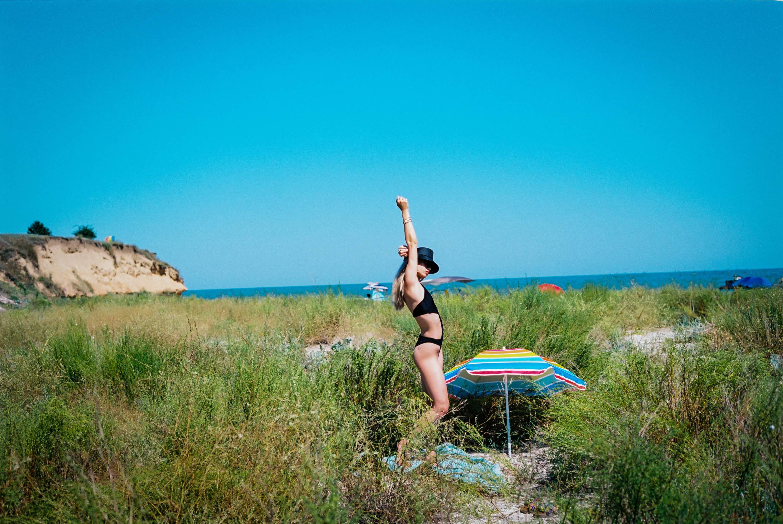 model standing on beach