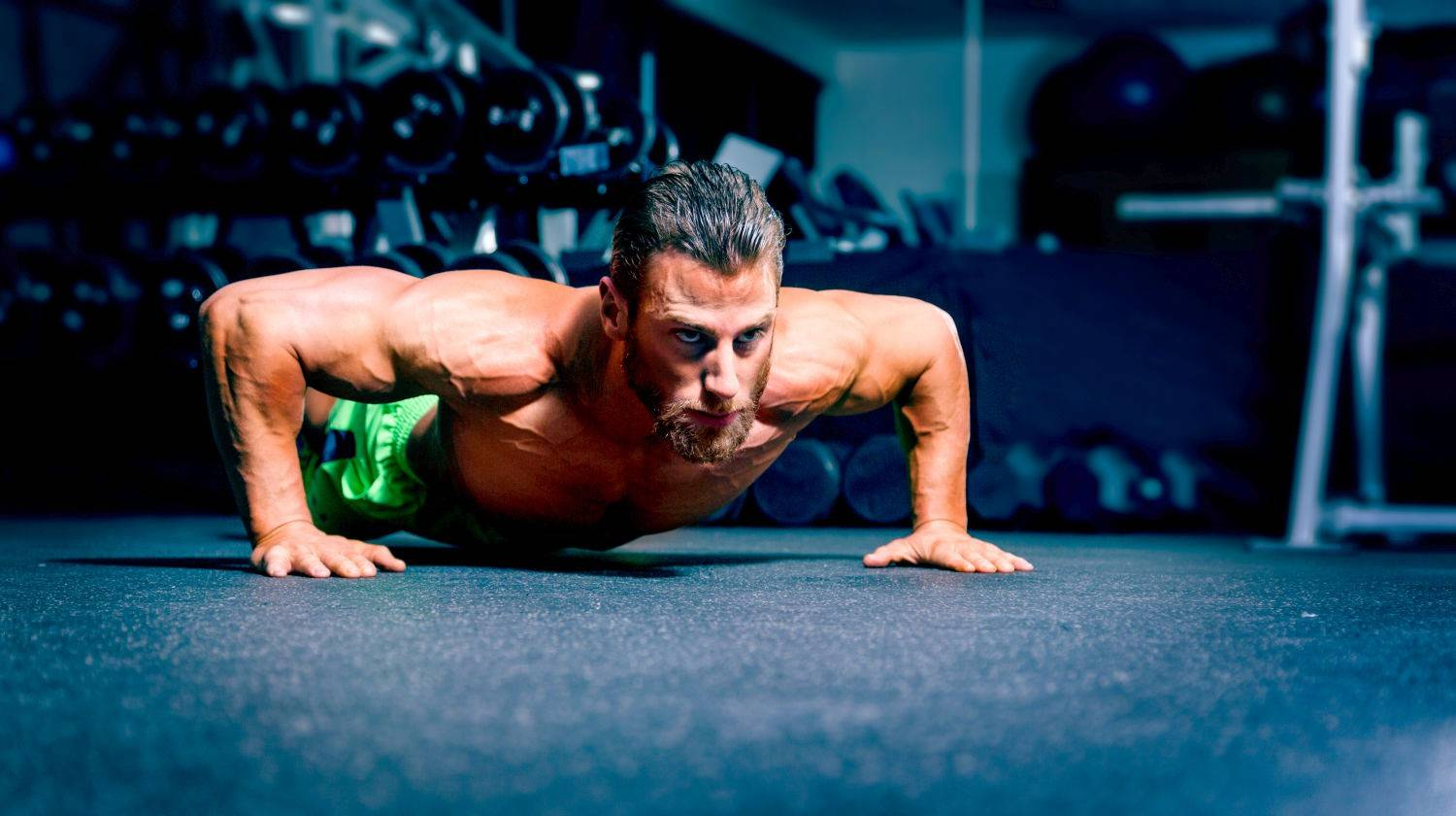 Ambassador Tim McComsey doing wide angled pushup | The Best Super High-Rep Training With HIIT 100s Workout | Featured | hiit workouts with weights