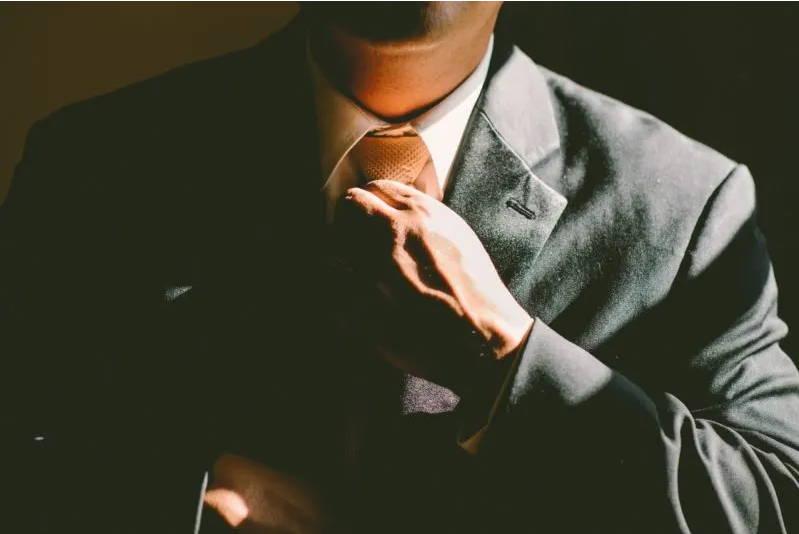Man Holding Tie