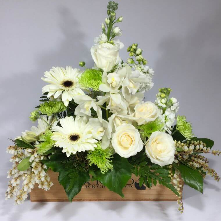 White flowers in a small box for a coffin