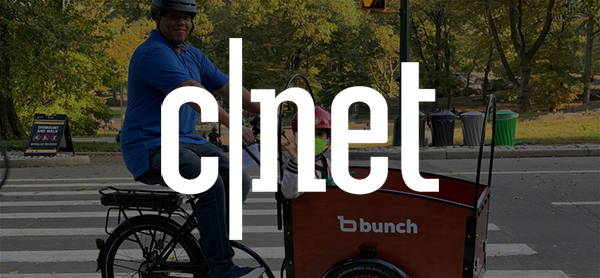 Cnet Logo over Man and Child on Bunch Bike