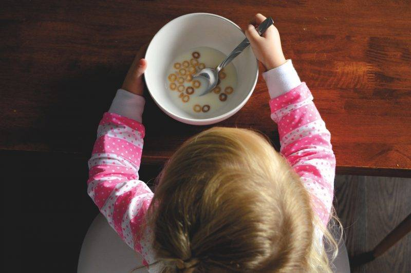 Child Eating A Bowl Of Cereal