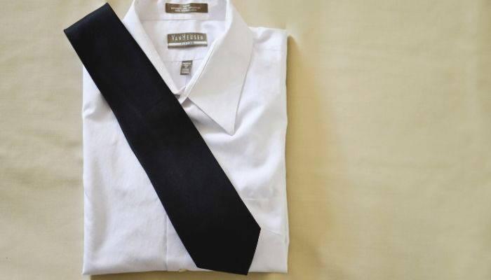 Black necktie on a white dress shirt