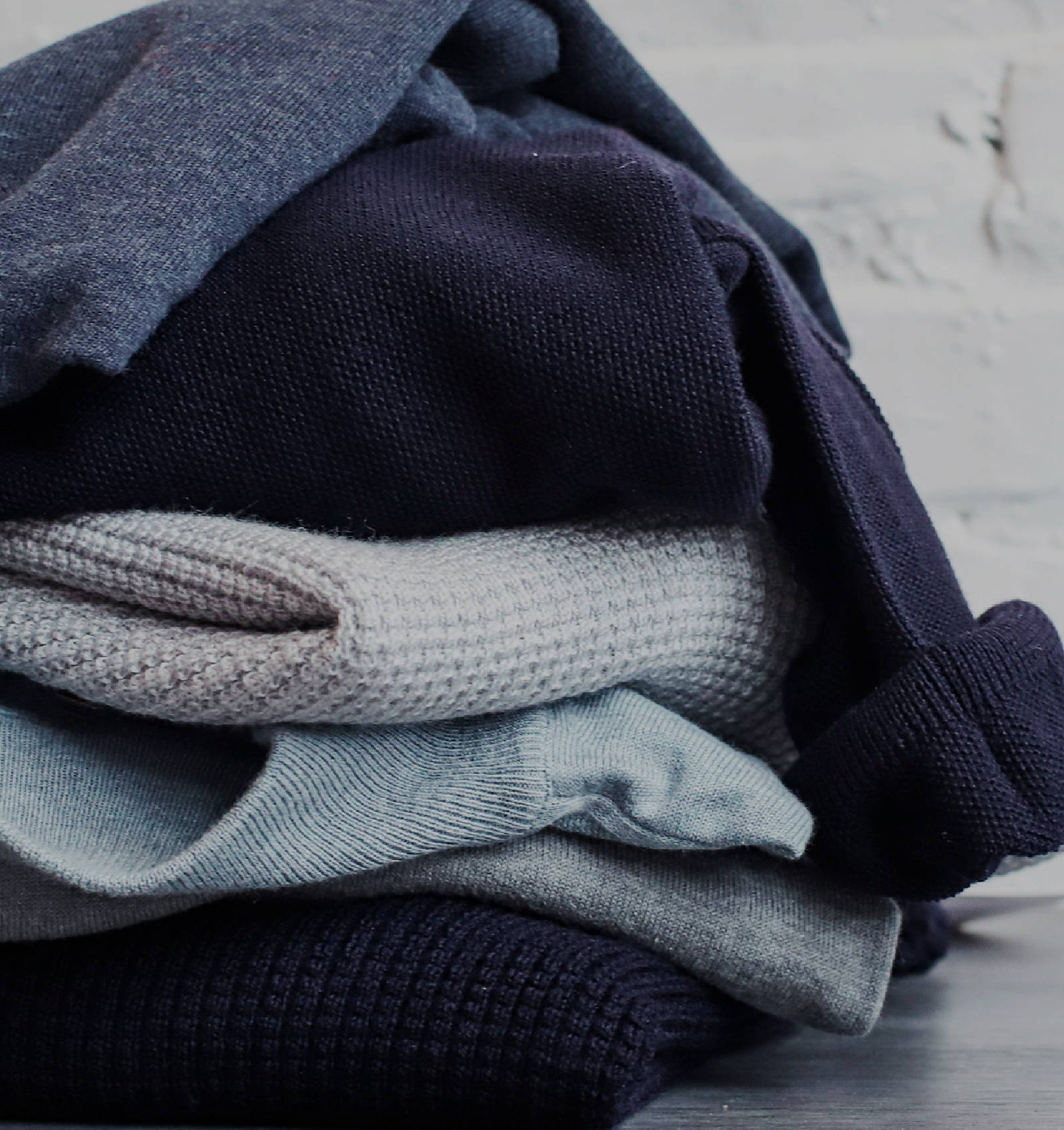 Stack of blue and gray Ledbury sweaters.