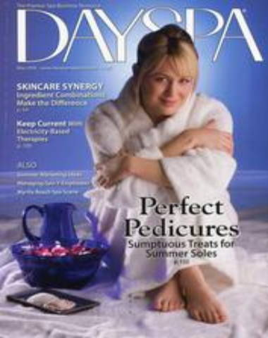 DAYSPA magazine cover, woman sitting with legs pulled to chest in white robe
