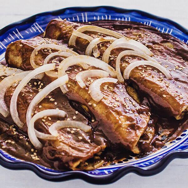 High Quality Organics Express Mole Enchiladas with onions