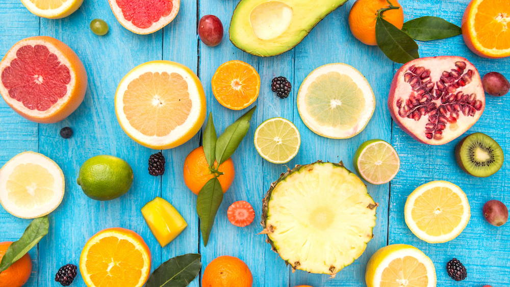 Cut healthy fruit snacks on a blue backdrop