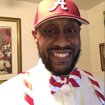 A customer rocking our red and white striped bow tie and suspender