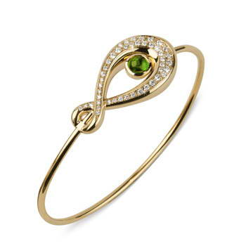 Thin gold bracelet with green gem center and pave set diamonds