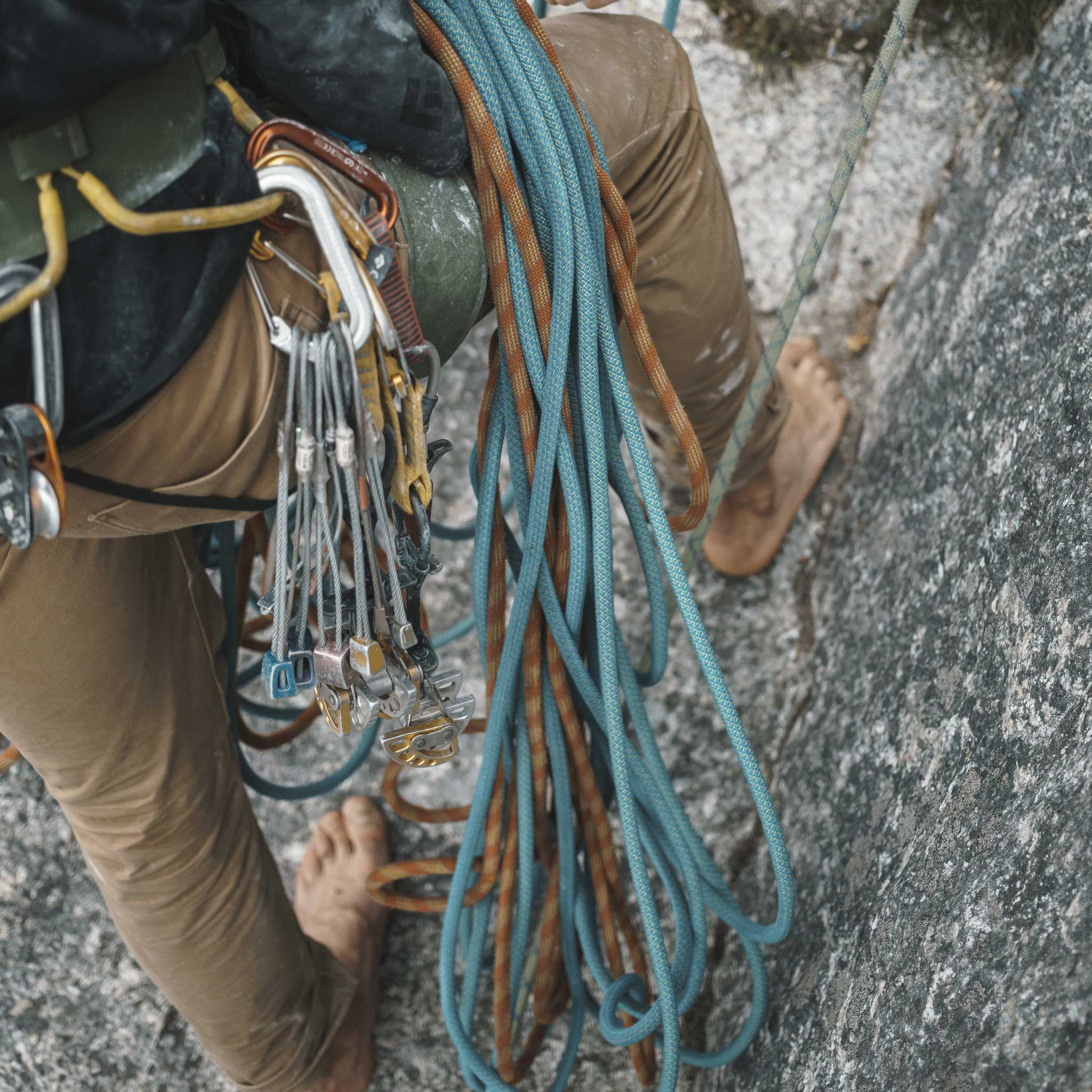 Man belaying rock climber while wearing Nelson Pant