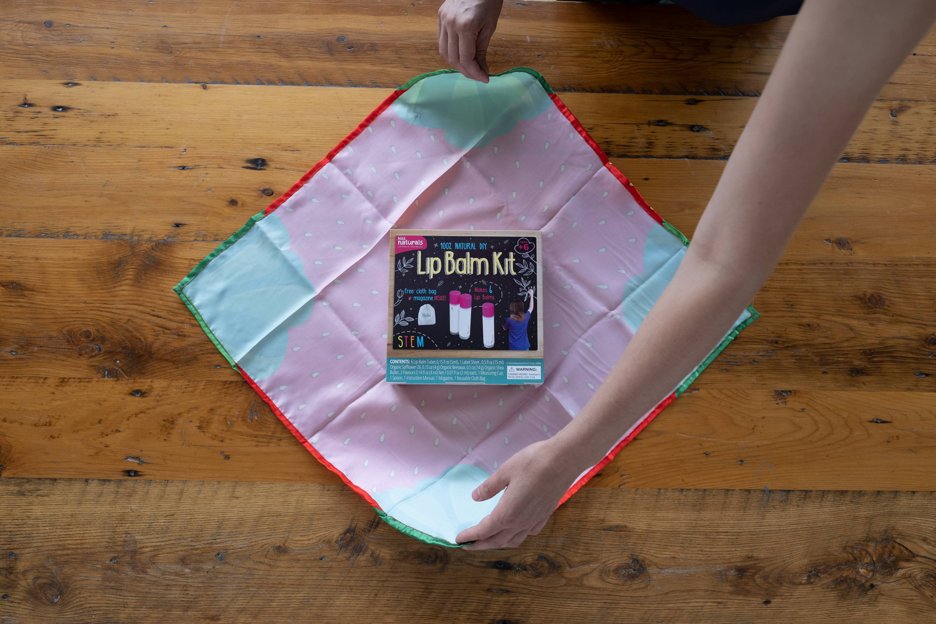 Lay kit on furoshiki gift wrapping cloth. Cloth should be perpendicular to kit.