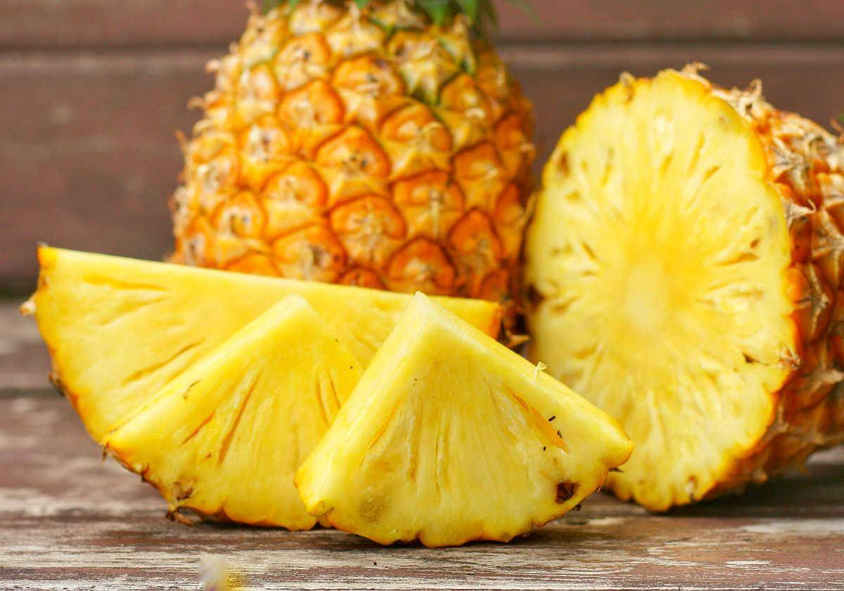 Sliced and whole of Pineapple(Ananas comosus) on wooden table background | Foods For Sinus Health & Ways To Relieve Infection | ways