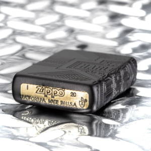 2020 Harley-Davidson® Collectible lighter laying flat on a metal surface, showing the bottom stamp