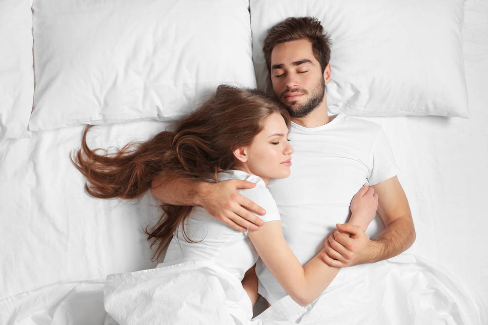 Young Couple sleeping in bed|How to get better quality sleep