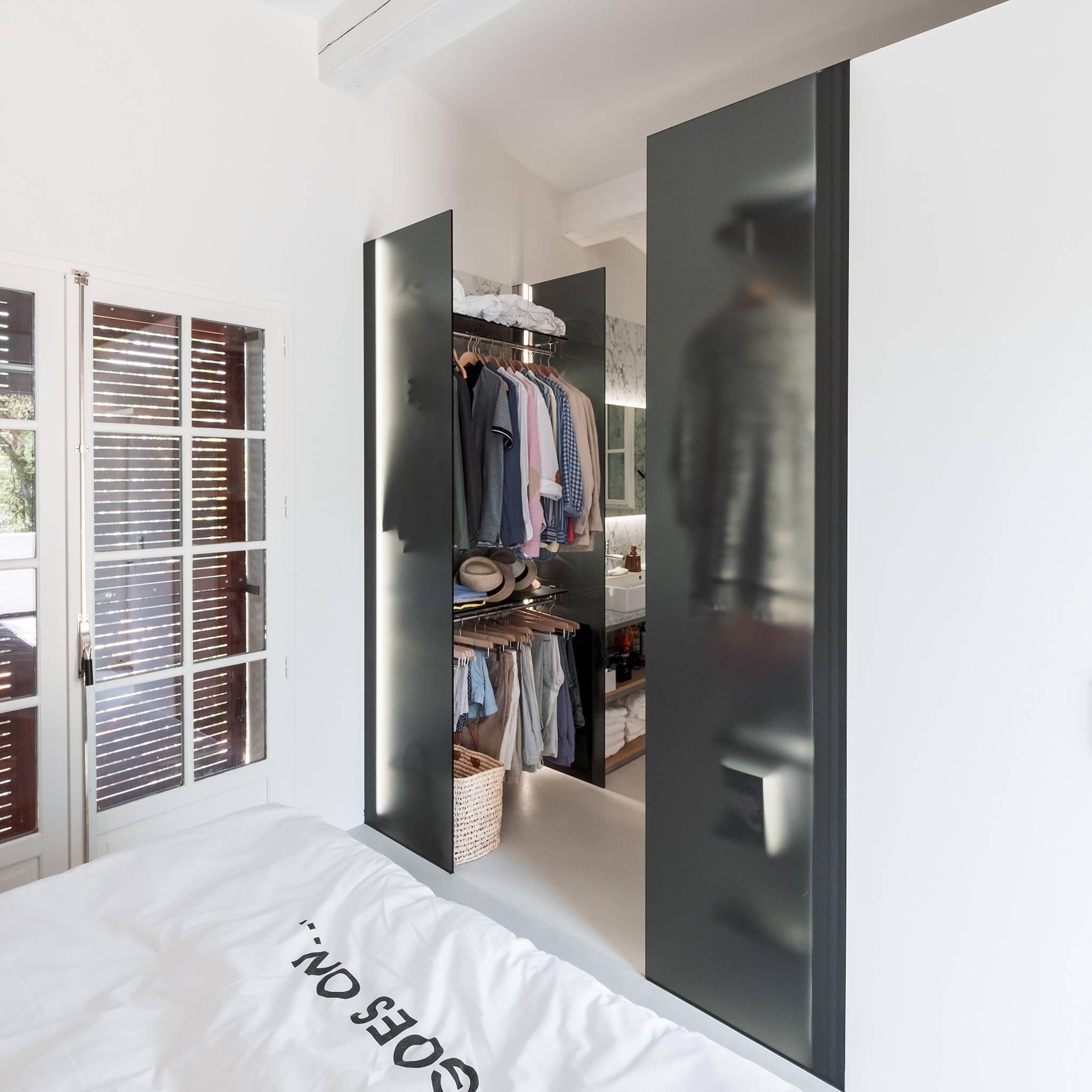 Walk-in closet with glass arrangements