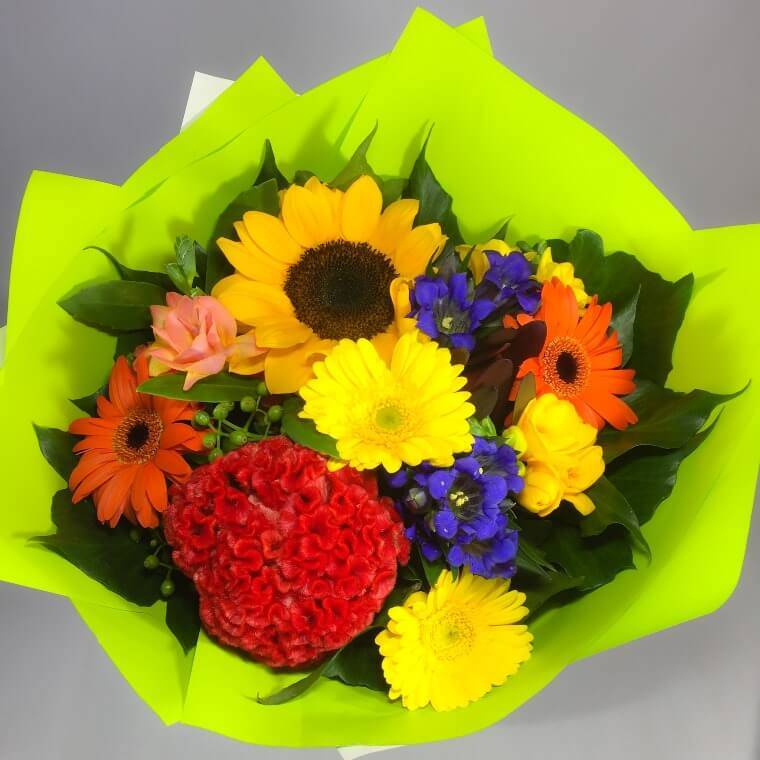 Bright bunch of flowers with gerberas and sunflowers