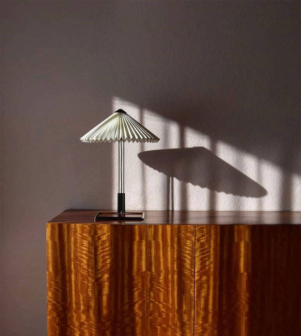 Matin table lamp sits on a cabinet