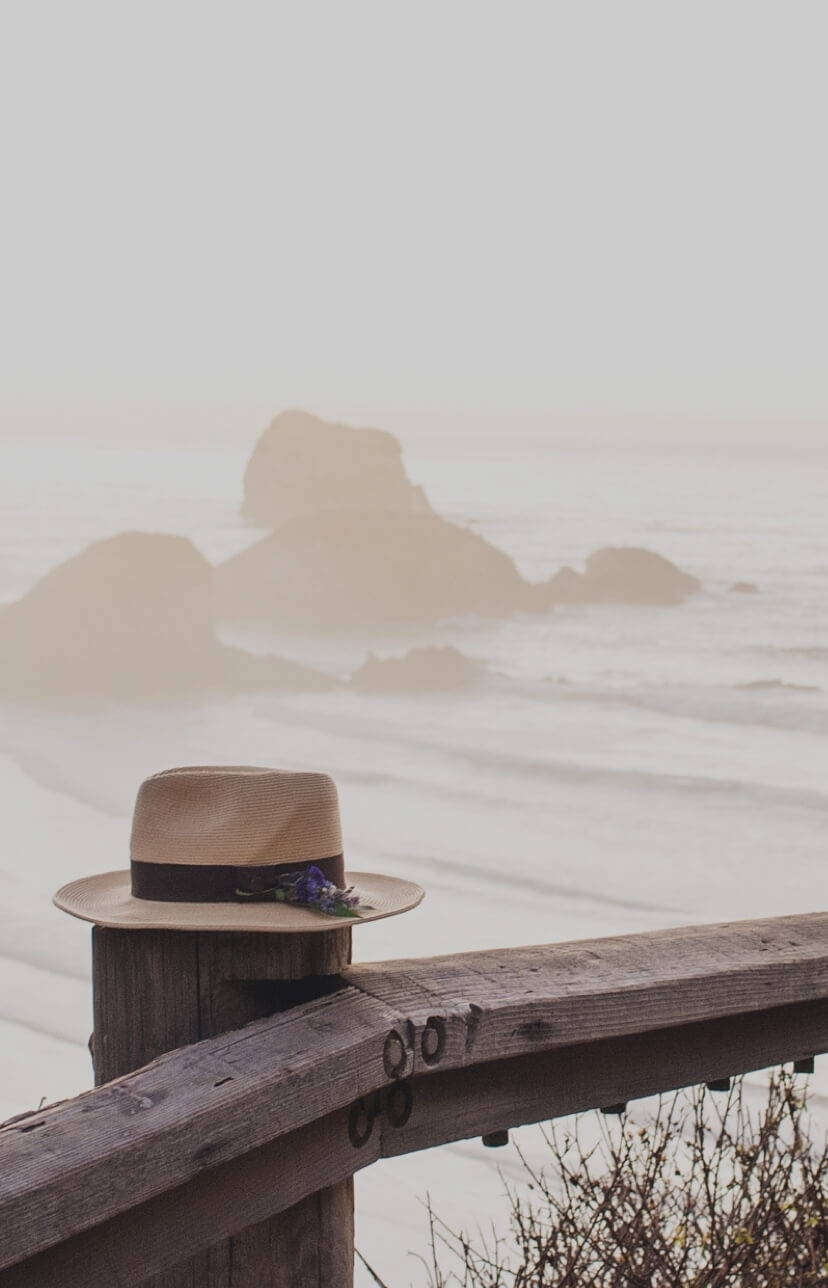 Hat sitting on a dock over the ocean