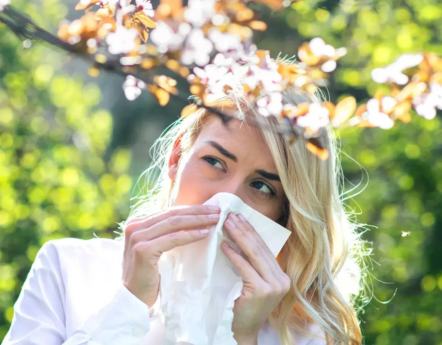 Young woman with seasonal hay fever