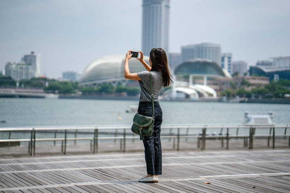 Traveler taking a photo of the scenery.