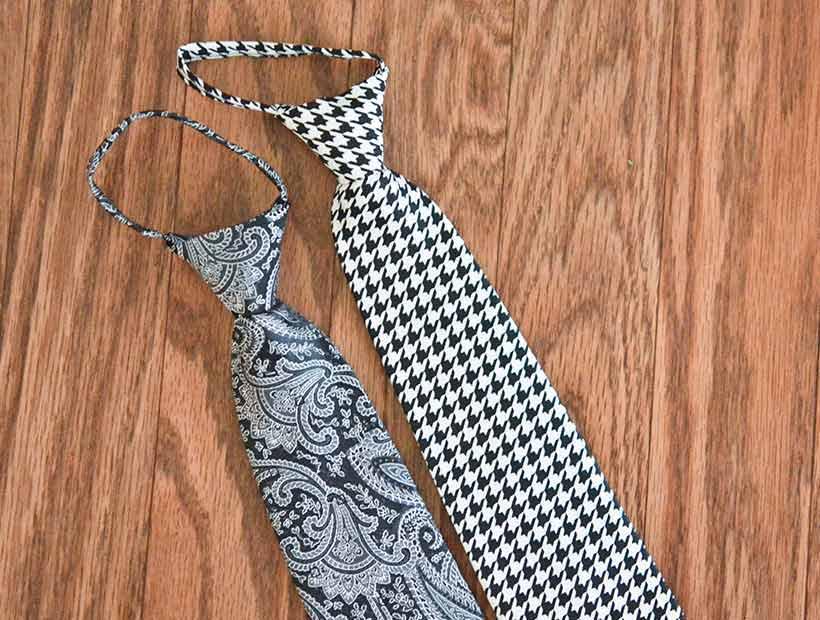 Black pattern pre-tied zipper ties displayed flat on a wood floor
