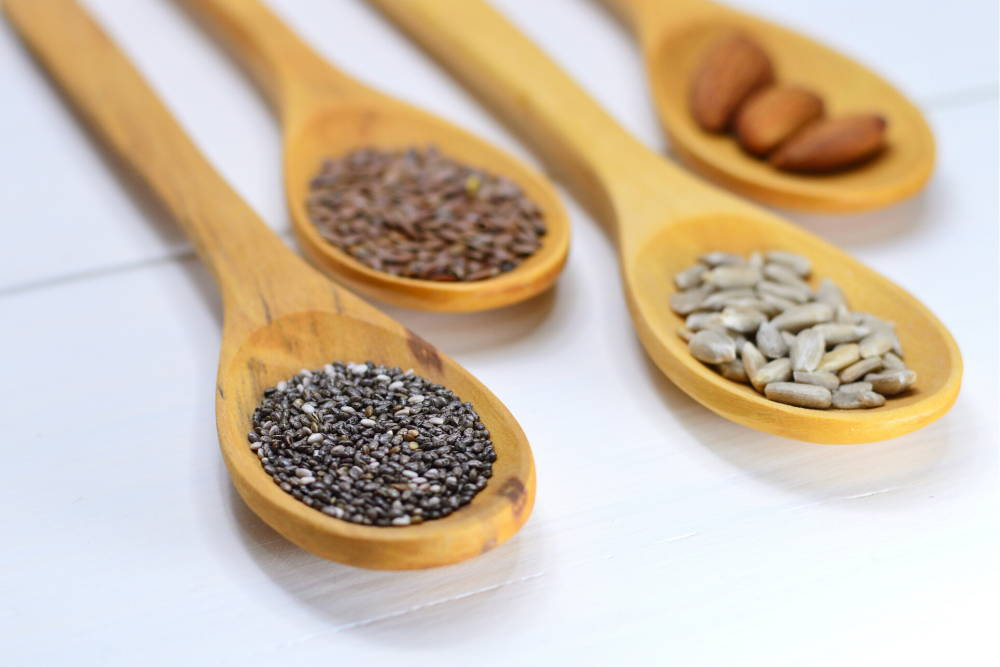 nuts and seeds in wooden spoons|vitamin e to improve white blood cells