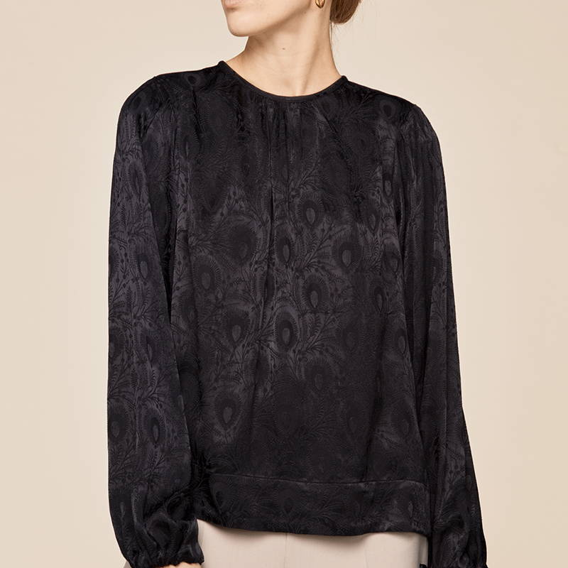 Product photography of a black lace design blouse from By Timo