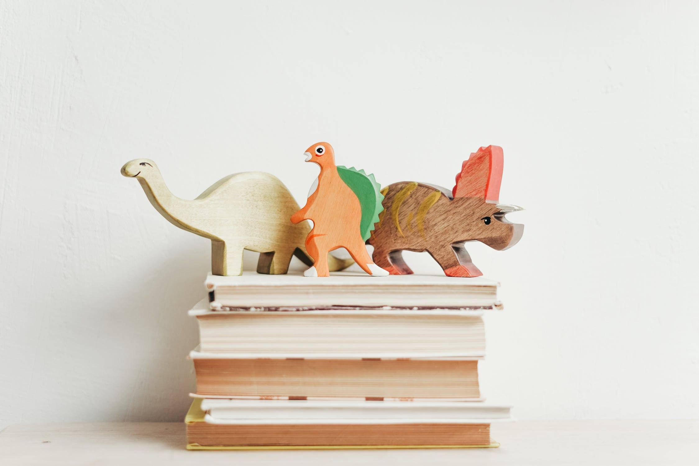 Dinosaurs on a stack of books
