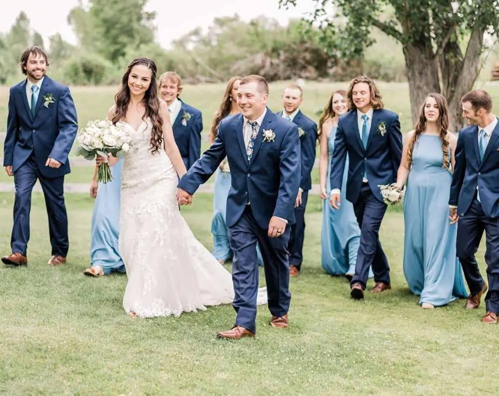 Wedding party wearing dusty blue