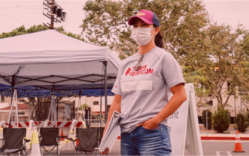 Woman wearing a face mask and holding a dossier