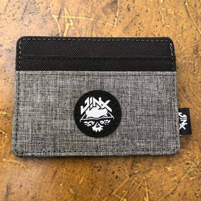 Photo of gray and black Jinx wallet.