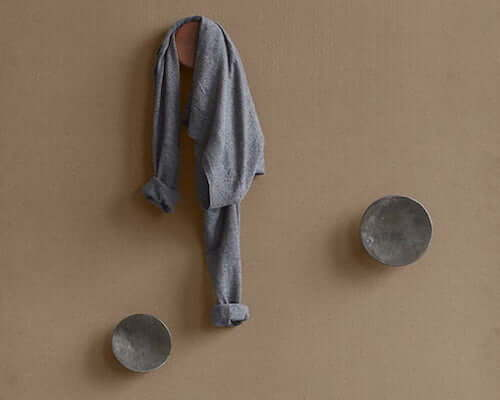 Hang up your coat in style with a wall hook or modern coat rack.