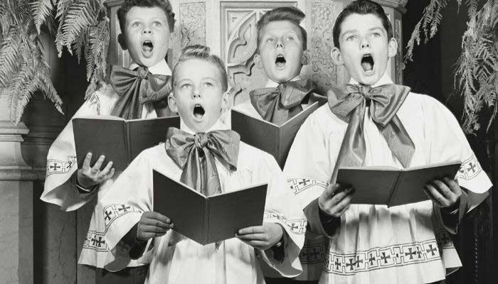 Vintage photo of choir boys singing wearing oversized bow ties