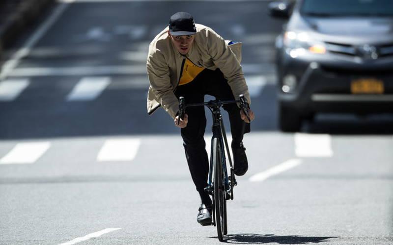 Chari & Co model on bike in city