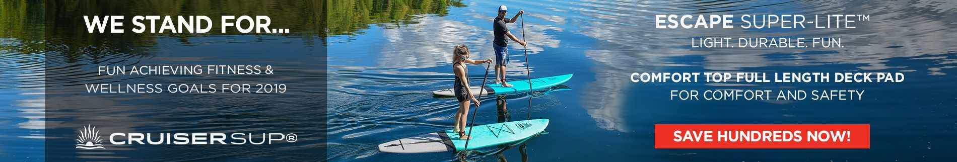 A man and woman riding SUP boards