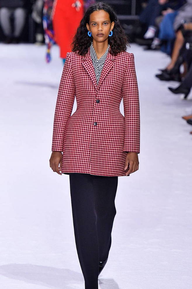 Girl on runway in plaid suit