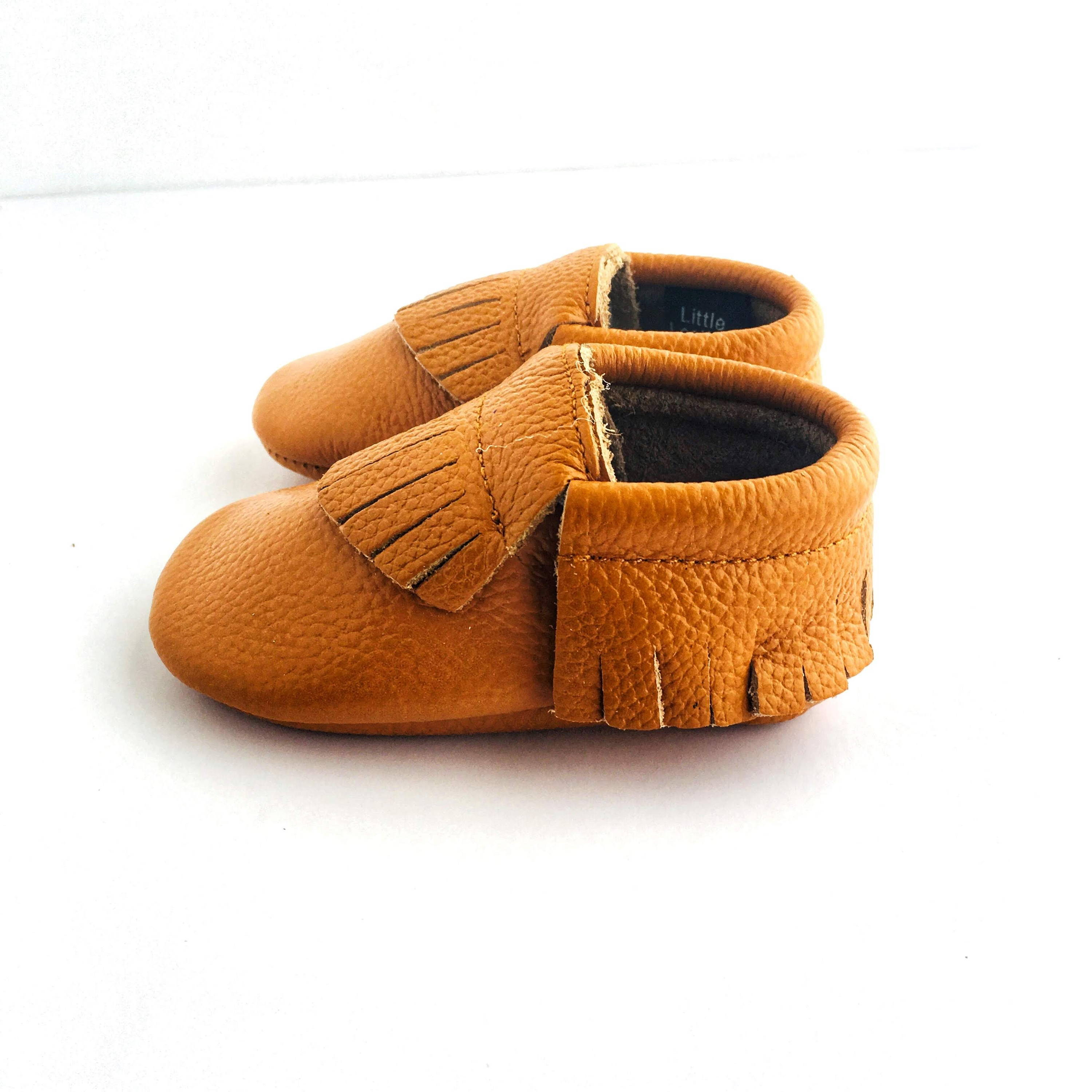 Caramel colour soft sole shoes with fringe sole view