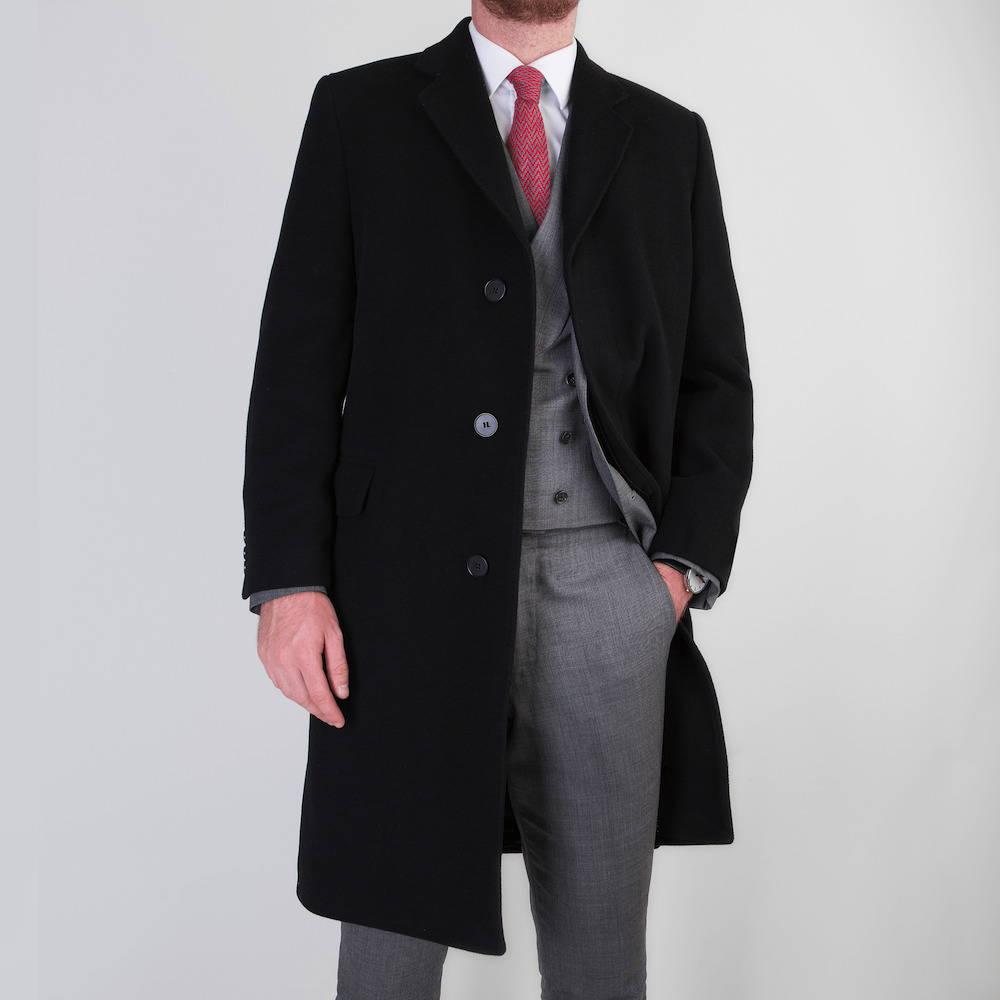 Gentleman wearing bespoke overcoat with Mullen and Mullen business suit underneath