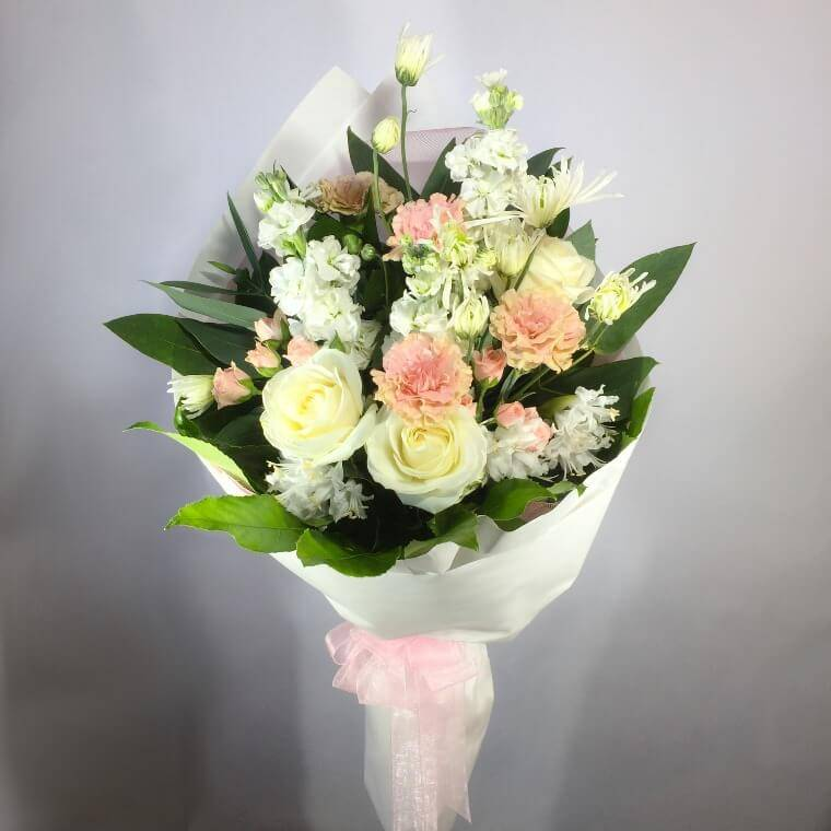 soft coloured flowers in a roll wrap