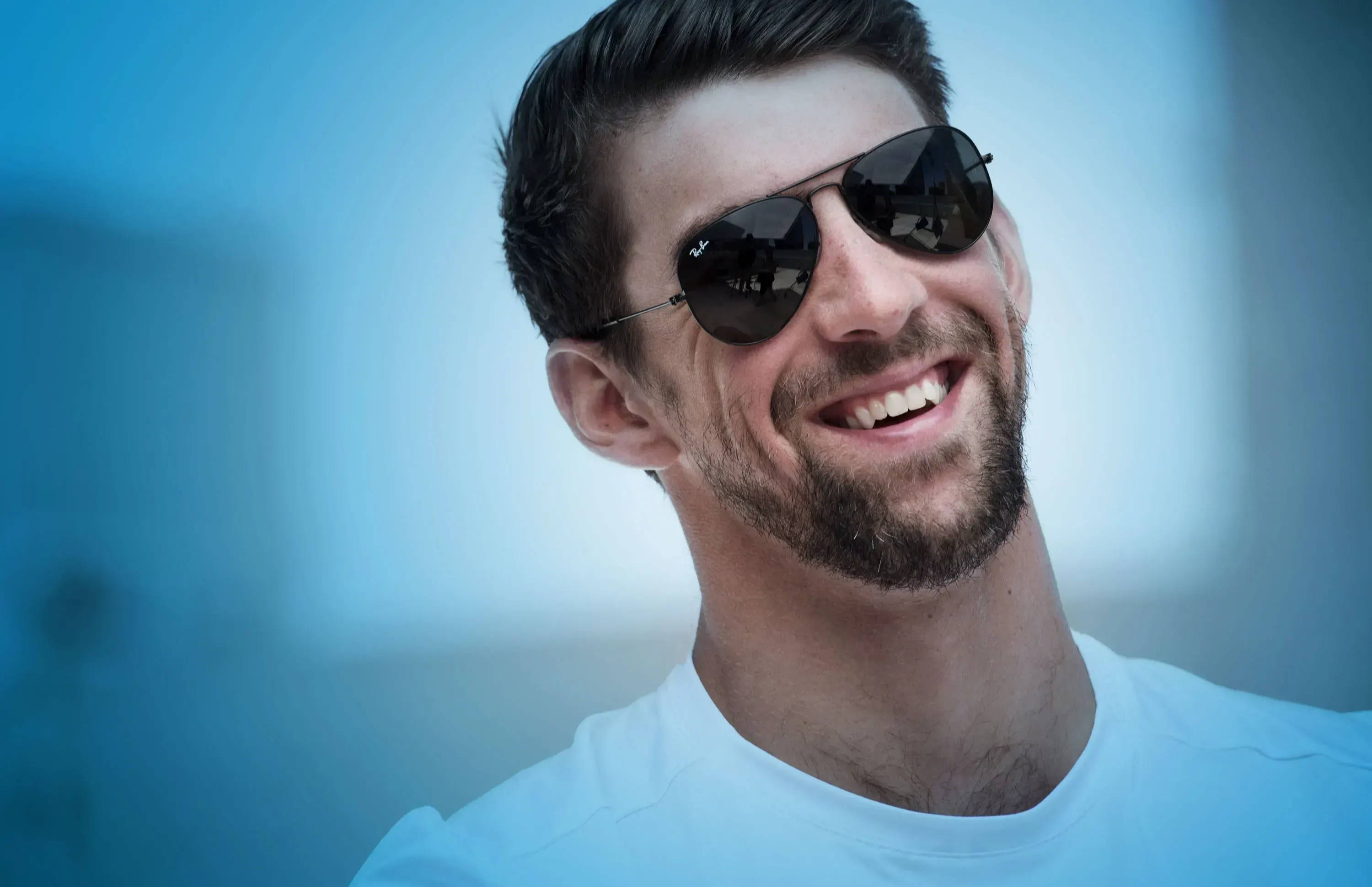 Michael phelps smiling wearing glasses announcing the Phelps swimming gear test team