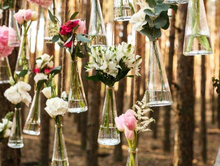Wedding reception flowers hanging in vases