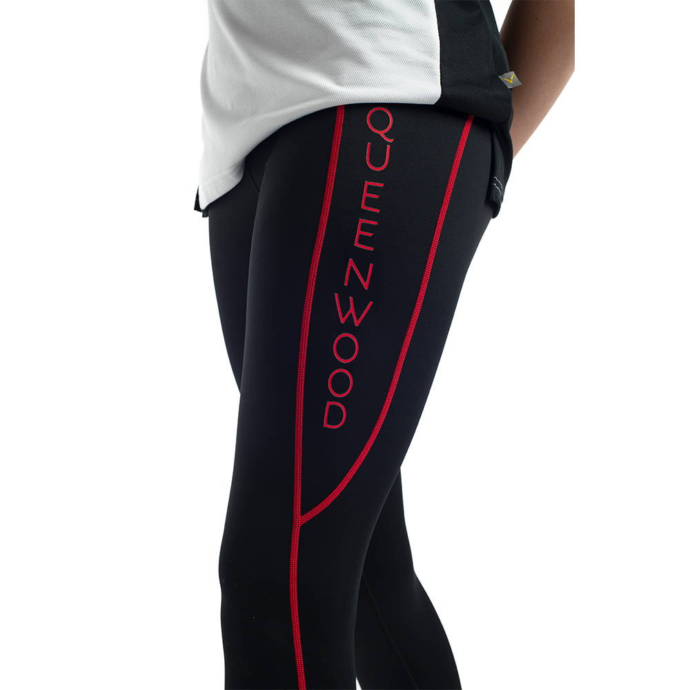 Custom compression tights featuring contrast stitching and heat seal printing for Queenwood School.